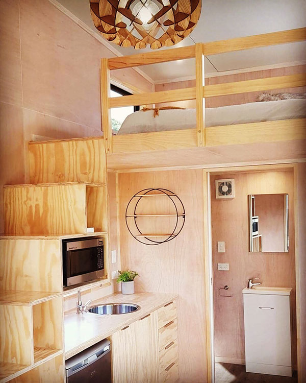 Tiny House storage stairs in ply, showing kitchen
